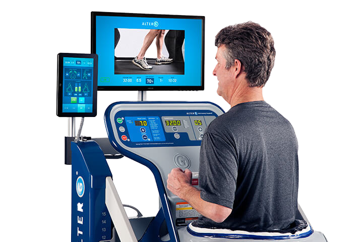 A man running on the Alter G featuring the tablet and video system.